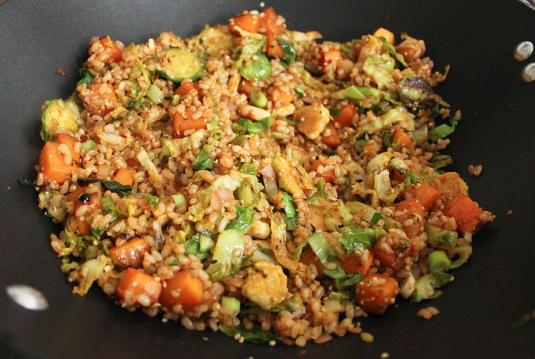 Add the roasted squash and Brussels sprouts to the pan along with the ...